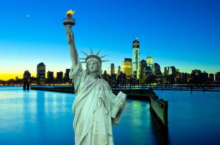 Liberty Statue with New York ar night