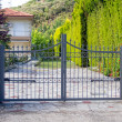 Steel security gates protecting house...