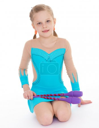 cute girl gymnast with sports maces.