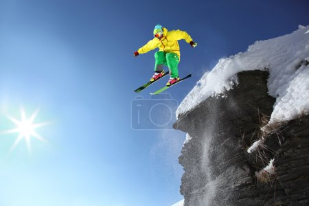 Photo for Skier jumping against blue sky from the rock - Royalty Free Image