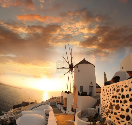 Photo for Windmill against colorful sunset, Santorini island in Greece - Royalty Free Image
