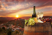 Bottle of white wine with barrel on vineyard in Chianti, Tuscany, Italy