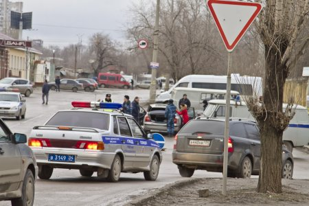 A police car goes in the stream. Active actions of the police after the terrorist attacks in the city
