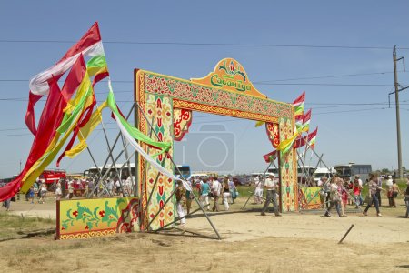 Decorated with the flags of the gate with the words Sabantuy
