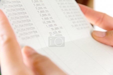 Hand holding bank account book