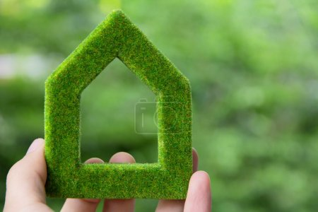 Photo for Hand holding green house icon - Royalty Free Image