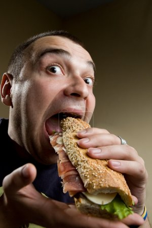 Photo for Man Eating Sandwich - Royalty Free Image