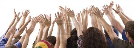 Men and women raising hands