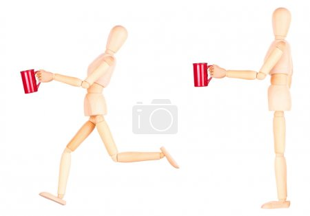 wooden Dummy with red cup of coffee