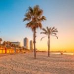 Barceloneta Beach in Barcelona with colorful sky a...