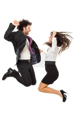 Photo pour Un bel homme d'affaires et une magnifique femme d'affaires sautant par-dessus un fond blanc - image libre de droit