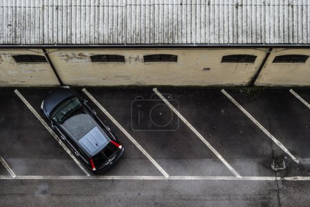 Photo for A small parking lot seen from above, with only one car - Royalty Free Image