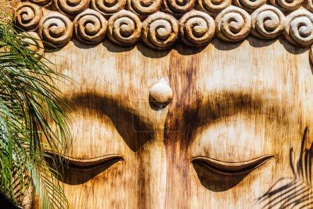 Photo for Detail of a wooden zen sculpture in a zen garden - Royalty Free Image