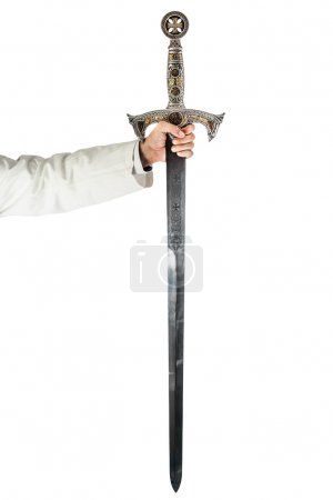 A hand holding a long and ornated medieval steel s...