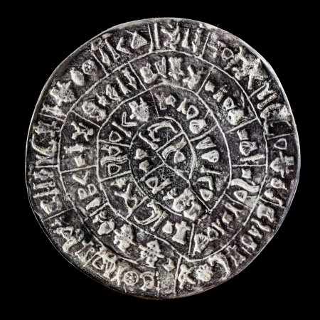 Photo for The Phaistos Disc is a disk of fired clay from the Minoan palace of Phaistos on the Greek island of Crete - Royalty Free Image