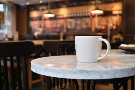 Photo for Closeup of a cup of coffee at coffee shop - Royalty Free Image