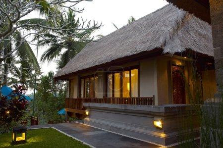 Photo for Illuminated resort villa at evening, bali, indonesia - Royalty Free Image