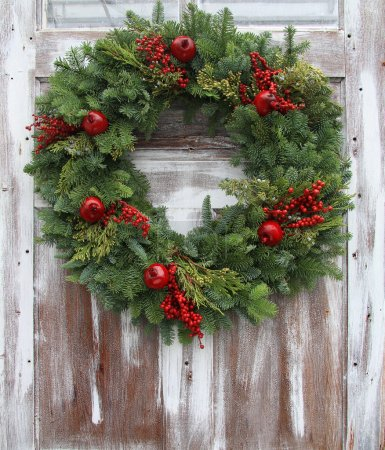 Photo for Christmas wreath on a rustic wooden front door. - Royalty Free Image