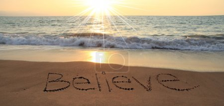 Photo for Believe written in the sand at the beach - Royalty Free Image
