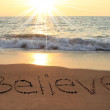 Believe written in the sand at the beach...