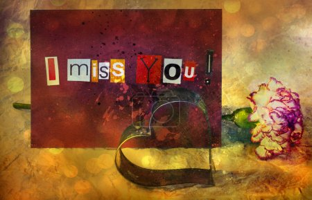 I Miss You. sentiment spelled out with cut out letters. Card with pink carnation flower and Cookie cutter in shape of heart