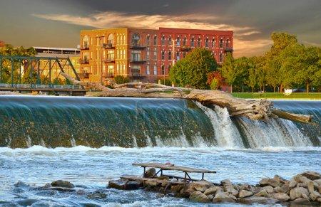 Old log balanced on top of dam in Grand Rapids, Mi...