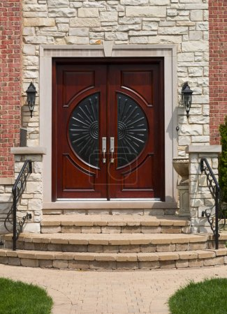 Photo for Mahogany brown wooden front door - Royalty Free Image