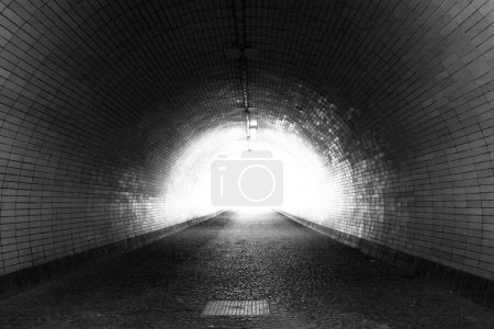 View Through a Dark Tunnel With the Light at The End (Black and White)