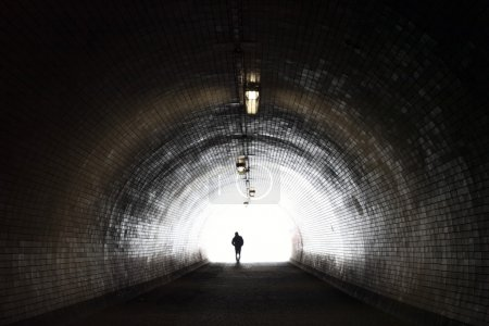 Photo for Human Silhouette in Light at The End of The Tunnel (horizontal shot) - Royalty Free Image