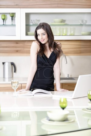 Woman reading recipe book