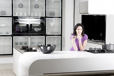 Woman in elegant kitchen