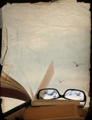 vintage background, books and glasses, dreaming of the vacation