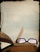 Vintage background, rose-coloured spectacles and old books