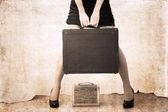 Artwork in vintage style, beautiful woman holdind heavy bag
