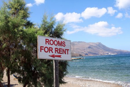 Rooms for rent sign on beautiful beach