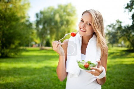 Photo for Woman eat salad after exercise - Royalty Free Image