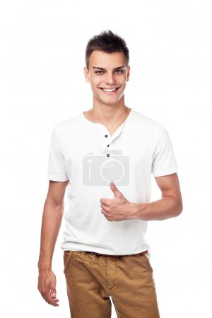 Casual young man isolated thumbs up