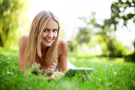 Young woman using tablet outdoor