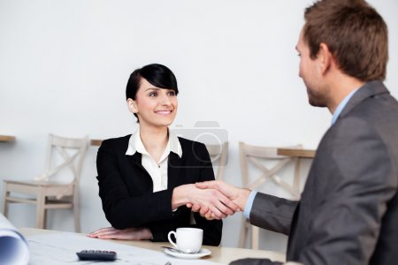 Photo for Two businesspeople shaking hands - Royalty Free Image