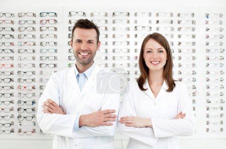 Team of happy opticians optometrists