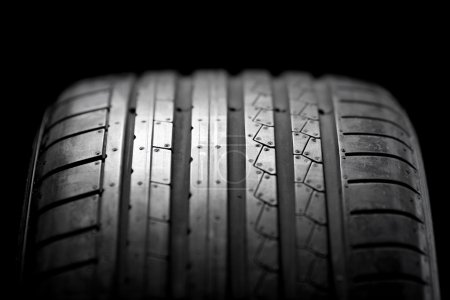 Sport summer tire isolated on black