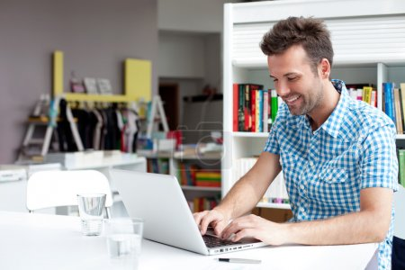 Photo for Happy student working on laptop in library - Royalty Free Image