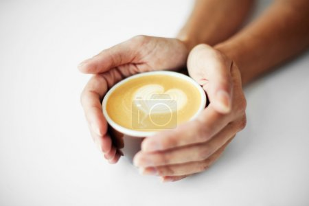 Female hands holding caffee
