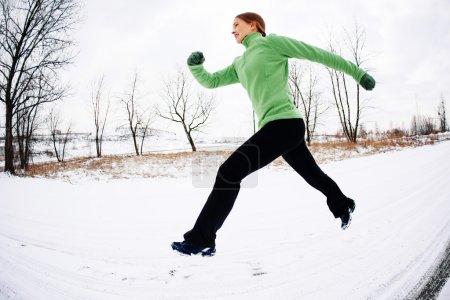 Woman training running in winter