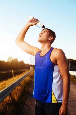 Athlete drinking after workout.