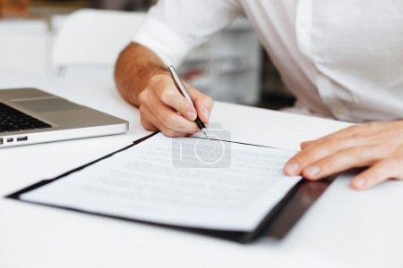 Photo for Close up of entrepreneur signing contract - Royalty Free Image