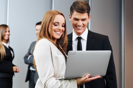 Two business people with laptop