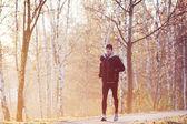 Man running at autumn morning