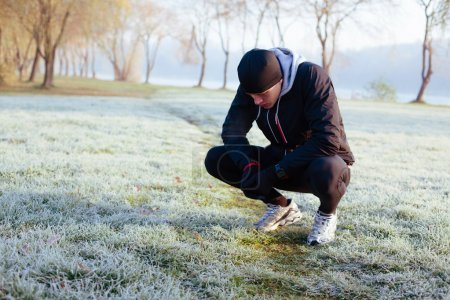Photo for Atlete resting after winter run at morning - Royalty Free Image