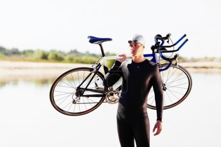 Triathlonist preparing for bike race